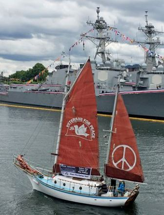 Click image for larger version  Name:Sara Golden Rule in front of 2 war ships Small.jpg Views:55 Size:34.4 KB ID:183119