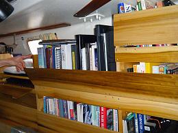Click image for larger version  Name:Port-side-main-cabin-bookshelf.jpg Views:67 Size:236.1 KB ID:243085