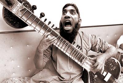 Click image for larger version  Name:rage-boy-sitar.jpg Views:76 Size:41.7 KB ID:29695