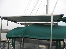 Click image for larger version  Name:Two 130w solar panels over bimini.JPG Views:576 Size:58.5 KB ID:8481