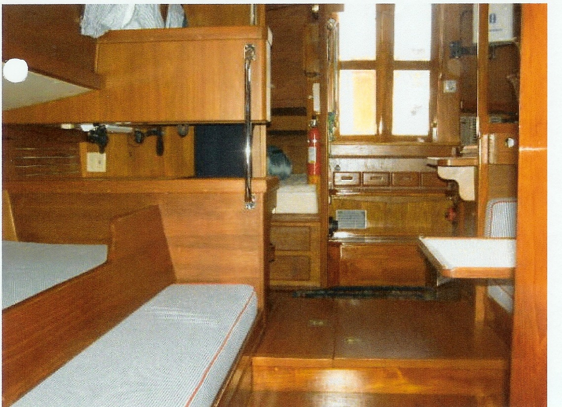 Click image for larger version  Name:Looking Aft from V Berth. On the left is a Sea Berth and a pull out berth, the back of the Nav S.jpg Views:253 Size:484.2 KB ID:8587
