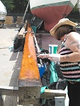 That's my girl! Giving the main mast a final coat of varnish!