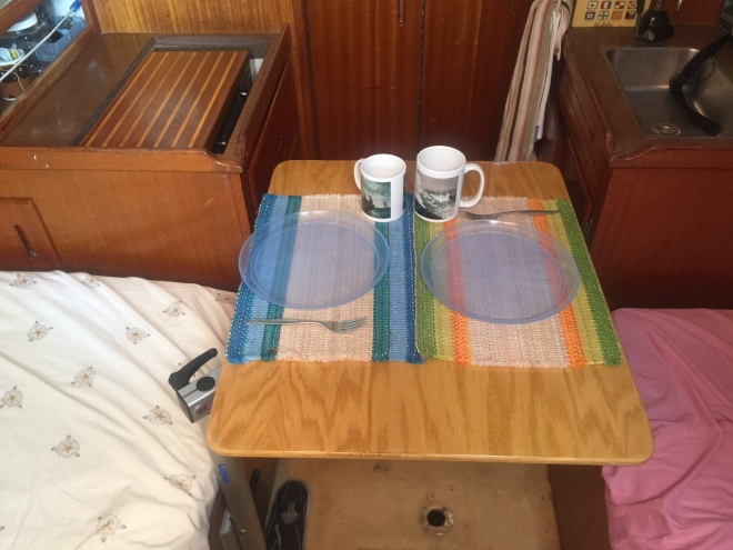 """Having the galley like this is rare in the older boats with the """"cruising interior"""" and this kind of beam, but it is really the best set-up IMO. (Most have the galley at the companionway and then have larger hatches under cockpit seats.) It is the most efficient use of space and I can lean against one side and jam my feet against the other to work while sailing. And I really don't need such large hatches under the cockpit."""